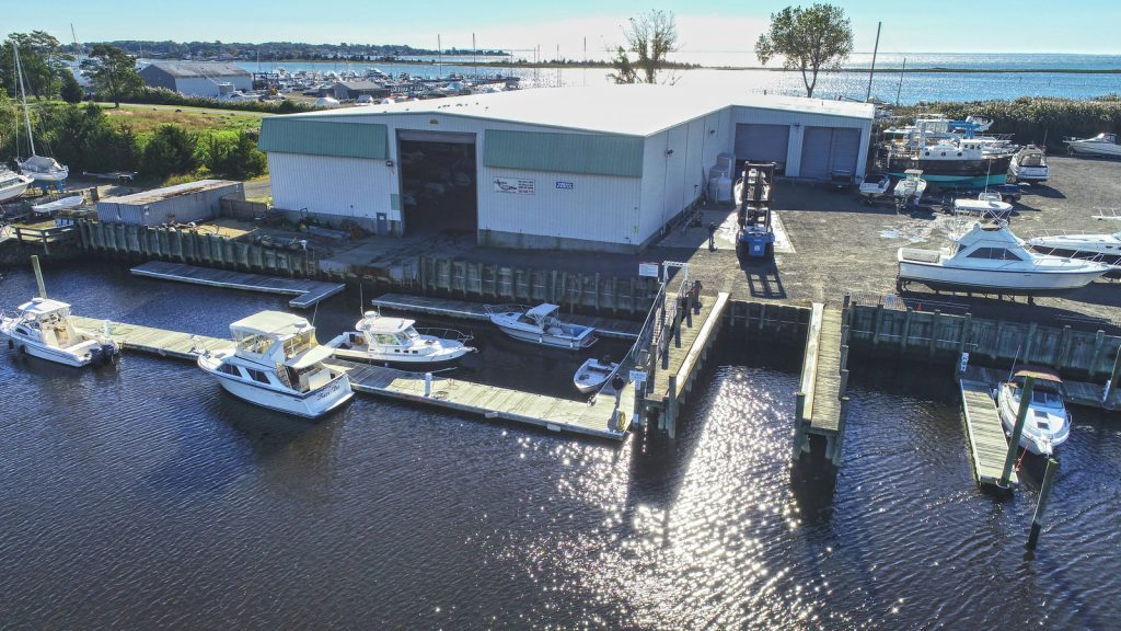 Boats are hauled and power-washed before being put back in the boat house.